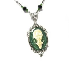 """Gothic Jewelry, Bone Jewelry, Real Bone Jewelry, Gothic Necklace, Macabre Necklace, Steampunk Necklace ONE OF A KIND  Mechanique Macabre's """"Wearable Oddities"""" brings to you:  A real  Rat Skull set in a custom crackled resin. Setting 40mm x 30mm and antiqued silver in color. Skull is coated i..."""