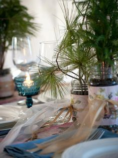 DIY Network shows you how to make budget wedding favors using recycled jars, wrapping paper and evergreen tree saplings.