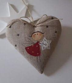 Sweet heart with an applied angel for your Christmas decoration. Hanging ribbon: jute ribbon with bow Size approx. 13 x 13 cm Material: high quality linen, - tilda and patchwork fabrics, . Christmas Makes, Felt Christmas, Homemade Christmas, Christmas Sewing, Christmas Embroidery, Christmas Projects, Christmas Crafts, Christmas Tree Ornaments, Christmas Decorations