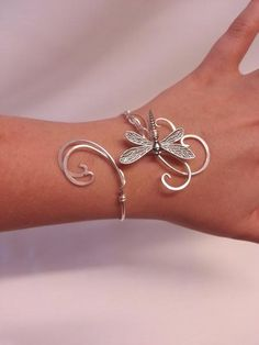 This is handmade dragonfly cuff bracelet made from silver plated metal intricately woven together to create this lovely elven inspired cuff perfect to wear every day or to special events and weddings Check my other items to see the matching necklace and matching circlet It is also available in Gold. The cuff is adjusta