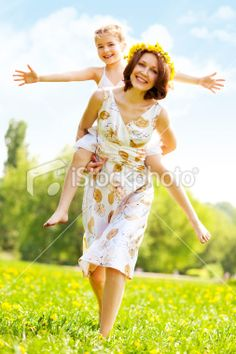 Mother and daughter having fun in park