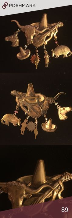 Large mid-western pin. Nice gold tone mid-western pin. Ox, hat and mandolin with 6 cute charms hanging from it. Jewelry Brooches