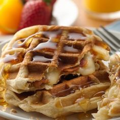Cheese and bacon-filled waffles made from crescents and topped with bourbon syrup!