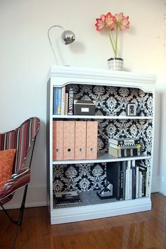 Transform your plain bookshelf. Add fabric before you put the back in place!