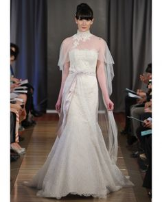 is that some kind of cape instead of a long veil...wow...love - modern lace wedding gown, Ines Di Santo, spring 2013