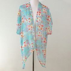 Floral Print Kimono-Like Size S Just Be brand. Beautiful & dainty floral print kimono-like size small. Has ivory color crotchet accent on both shoulders.   Base color is turquoise with floral print design throughout.   100% Polyester.   Super light. Adorable & perfect for spring or summer w/jeans, skirt or shorts!   OFFERS WELCOMED ON ALL MY ITEMS SO FEEL FREE TO MAKE ONE.   Thanks for browsing!❤️❤️❤️ Just Be Tops