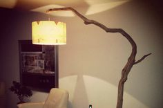 Floor Lamp / arc lamp, weathered old Oak branch on black natural stone base, including cord with dimmer switch and round lampshade made of real wood veneer (available in 2 colors) around 50x30 cm. total height is 228 cm. Oak branch is naturally weathered without sapwood and wind dried naturally in the forest, the color varies from light brown to gray weathered wood tones. The contraction scour in the wood caused by natural drying, and give the wood a very rustic look that fits perfectly in…