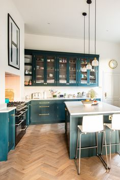 We recently designed and fitted this bespoke kitchen for the Hooper family (also. Colorful Kitchen Decor, Teal Kitchen, Kitchen Dinning, Kitchen Colors, Home Decor Kitchen, Home Kitchens, Kitchen Design, Dark Green Kitchen, Kitchen Ideas