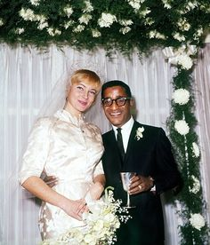 May Britt & Sammy Davis, Jr. at their wedding, 1960...This Union Caused Many Problems For Davis & His Bride Due to the Segregation of the Times...But, Good Friend, Sinatra, Made Sure This Couple Lived Where They Pleased, Davis Was Not Denied Jobs, and The Couple Were Brought, Warmly Into Hollywood Circles...Sadly, Davis' Schedule & Excesses Ended The Union After A Couple of Children...