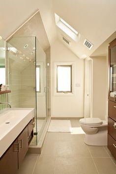 Horizontal panel stall tiles, brown wood cabinetry, large rectangular panel tile floor