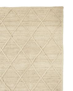 A rug with a beachy vibe makes everyone feel right at home. Made entirely of braided jute that's extra soft because it's been specially bleached, it beckons for bare feet. We love the subtle texture.