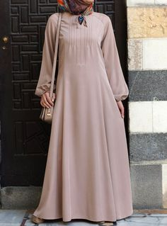 We love the voluminous sleeves on this modest dress. From shukronline.com