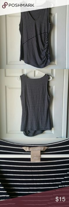 Banana Republic Sleeveless Blouse V-neck black and white striped blouse.  Has ruching detail on left hand side.  Perfect for under a blazer! Very comfortable excellent condition Don't forget to bundle for a discount or make an offer Banana Republic Tops Tank Tops