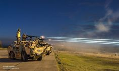 Pictured are tracer rounds from the .50 calibre Heavy Machine Gun mounted on a Jackal, streaking across the sky like lasers as soldier's fire during a night exercise. Flares were fired to illuminate the target area. Troops from the Light Dragoons are back doing their normal activities after helping the country cope with the flooding over the festive period. Around 200 troops are now being trained as gunners - working into the night to practice their shooting at Warcop Training Area