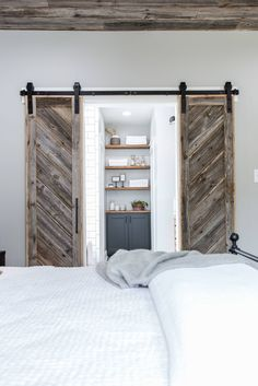 To match the ceiling, we also salvaged wood from the original structure for sliding barn doors leading into the master bathroom. Diy Bedroom Decor, Home Decor, Dream Bedroom, Sliding Doors, House, Bunk Beds, Furniture, Homemade Home Decor, Fantasy Bedroom