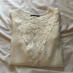 SOLEMIO Sheer Embroidered Top Beautiful white 100% sheer long sleeved shirt. There is a lace pattern in the shape of a v in the front of the top and the sleeves and bell sleeves. Crew neck neckline and a little on the longer side. Purchased at Nasty Gal Nasty Gal Tops Blouses