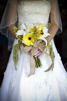i just love the bow! Sunflower Wedding Bouquet ... I think I would do navy bow and navy dresses :)