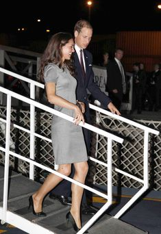 July 2, 2011 - Catherine, Duchess of Cambridge and Prince William, Duke of Cambridge smile as they arrive on board HMCS Montreal in Montreal Canada.