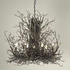 Okay we all know I want a chandelier but this one . . .is scary! Naturally Superior Twig Chandelier