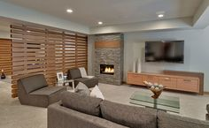 The dividing wall creates two spaces yet allows air and light to flow between both areas.     http://www.houzz.com/photos/9314996/27-Bridge-Lake-Dr-contemporary-basement-other-metro