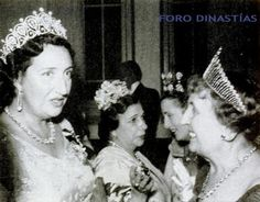 On the left King Felippe's grandmother, wearing the Cartier Loop tiara, and on the right the Condesa de Los Andres, wearing a similarly high diamond tiara with many more, approx 30, loops