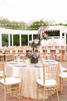 Love the mixed use of tables, some round, and some family style. Plus who doesn't love a sparkly table cloth! A Chic Plum & Champagne Wedding