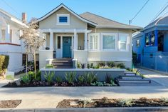 Adding a functional walkway from the driveway and replacing the wide siding columns with smaller, white columns on the porch give the house the lift it needed. Subtle touches of blue create a refreshing feel to keep this home feeling young at heart.
