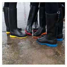 Black Llse Jacobson rainboots with electric soles - Love the pop of color!