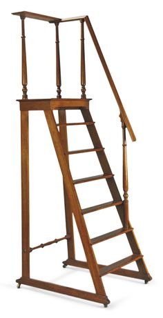 A NORTH EUROPEAN NEOCLASSICAL CARVED AND STAINED FRUITWOOD LIBRARY STEP LADDER MID-19TH C.; height 84 in.; width 35 in.; depth 20 1/2 in. / 213.5 cm; 89 cm; 52 cm