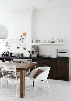 kitchen and dining with mismatched chairs