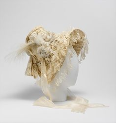 Bonnet    Date:      1830–35  Culture:      French  Medium:      silk, feathers  Dimensions:      Height: 14 in. (35.6 cm) Width: 10 in. (25.4 cm) Length (ribbons): 22 in. (55.9 cm)  Credit Line:      Isabel Shults Fund, 2004  Accession Number:      2004.343