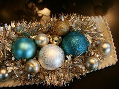 Ornaments and Garland on a Tray. So Simple! http://www.hgtv.com/handmade/34-handmade-holiday-decorations/pictures/page-34.html?soc=pinterest