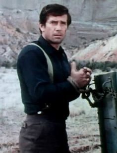 Him playing a bad guy doesn't work very well > Pvt. Sneed, tied to the wagon. The Gatling Gun, 1971