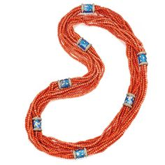 18 KARAT GOLD, CORAL BEAD, ENAMEL AND DIAMOND NECKLACE, SCHLUMBERGER, PARIS  Composed of seven strands of coral beads spaced at intervals by segments applied with blue paillonné enamel, the segments further decorated with round and navette-shaped gold studs and round diamonds weighing approximately 12.60 carats, length 54 inches, signed Schlumberger Paris, with French assay and workshop marks. via Jewels du Jour