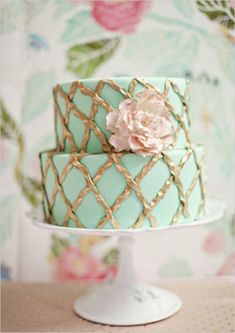 Mint and gold two-tiered cake with a blush pink flower - so adorable!