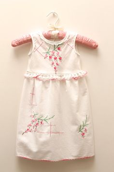 This sweet sleeveless classic dress is made from a vintage cotton tablecloth.
