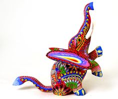 Google Image Result for http://www.oaxacafinecarvings.com/images18/auroraselef6.jpg