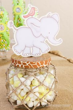 Here we used Mod Podge and paper to create a truely themed jar for our baby shower.