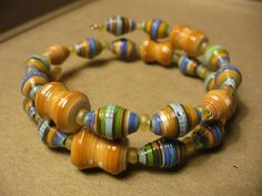 One of a kind Paper Bead memory wire bracelet by stillrain, via Etsy.