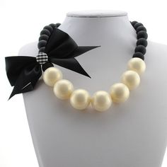 Statement necklace statement necklace. Pearl and black bow. Very elegant. New Retail Jewelry Necklaces