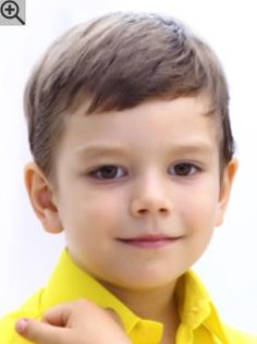 Short and neat haircut for little boys. The hair was cropped close and combed diagonally.