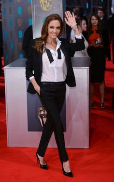 Angelina Jolie wore a sleek Saint Laurent tuxedo jacket and trousers to the 2014 BAFTAs.