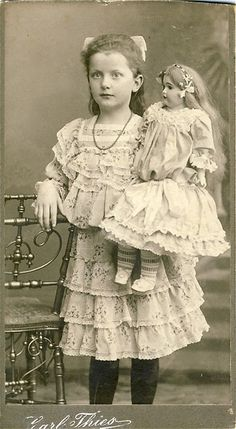 Antique photo of little girl with her doll.                                                                                                                                                     More
