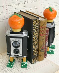 Fun Pair of Repurposed Camera Bookends by 1453designs on Etsy