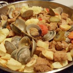 """Carne de Porco à Alentejana is one of the most traditional Portuguese dishes found on the menus of Portuguese restaurants through out the world. The dishes name, """"Alentejana"""" meas that the dish comes from the Alentejo region of Portugal. Pork Recipes, Seafood Recipes, Cooking Recipes, Recipies, Mussel Recipes, Portuguese Recipes, Portuguese Food, Pork Dishes, Seafood"""