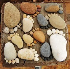Super cute idea :-D Especially as a momento for vacations involving nature, just jut because! Take some stones of various sizes and make little feet with them.