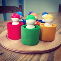 7 Rainbow Wooden Peg Dolls in Matching Bowls. Adorable! Made in Germany. From Bella Luna Toys.