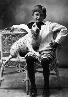 Boy posed with dog on wicker chair, c.1910, Florida
