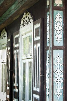 traditional decorative carved wood window frame + shutters, poland | architectural details