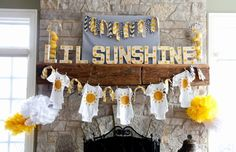 You Are My Sunshine Party Ideas- I like the idea of decorating with the same onesie pinned to a clothesline. Use various sizes and the guest of honor can wear throughout the entire first year